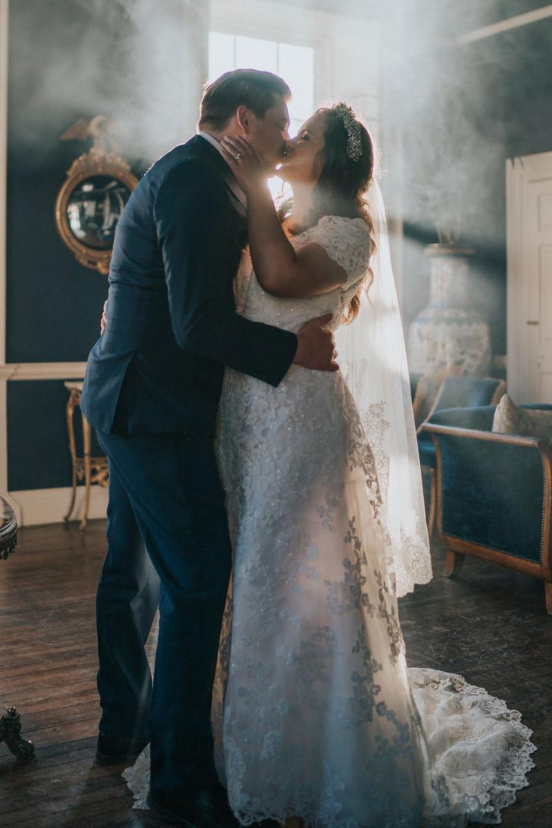 Bride and groom kiss with smoke effect - wedding photography Northumberland