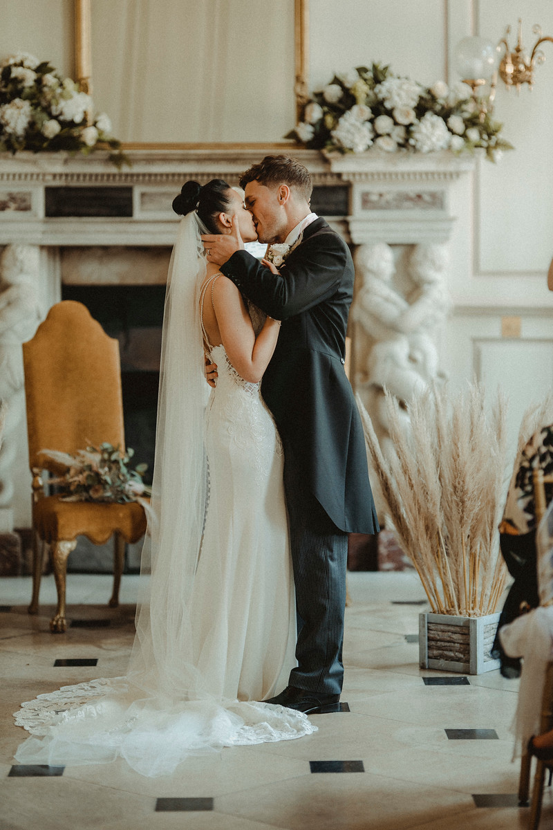 Bride and groom kiss wedding photo - Gosfield Hall Wedding Photos