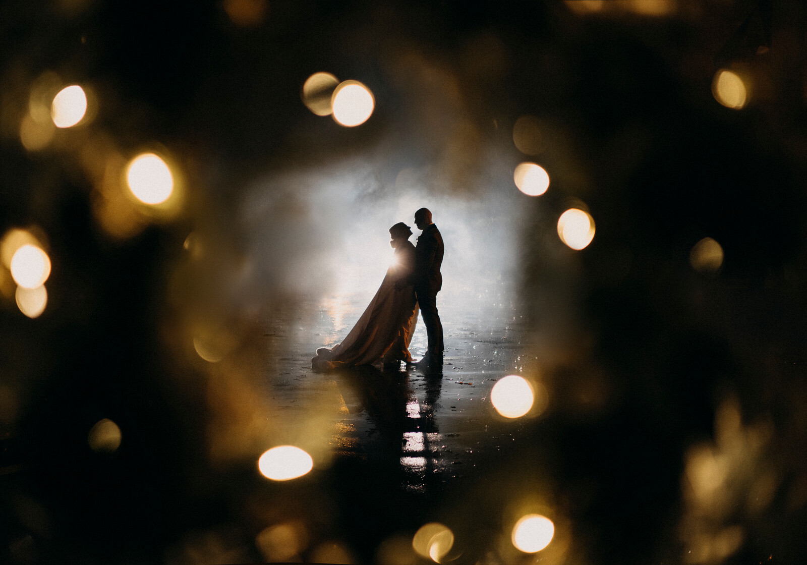 Bride and groom in the middle with lights all around them| Wedding photos