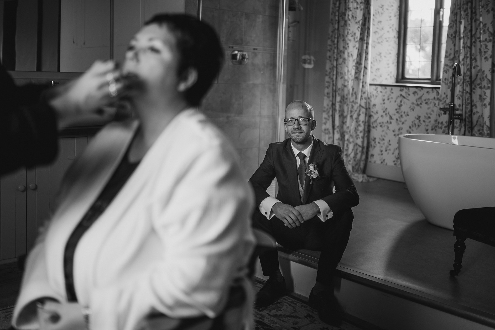 Brides son watches as she has her make up done for her big day