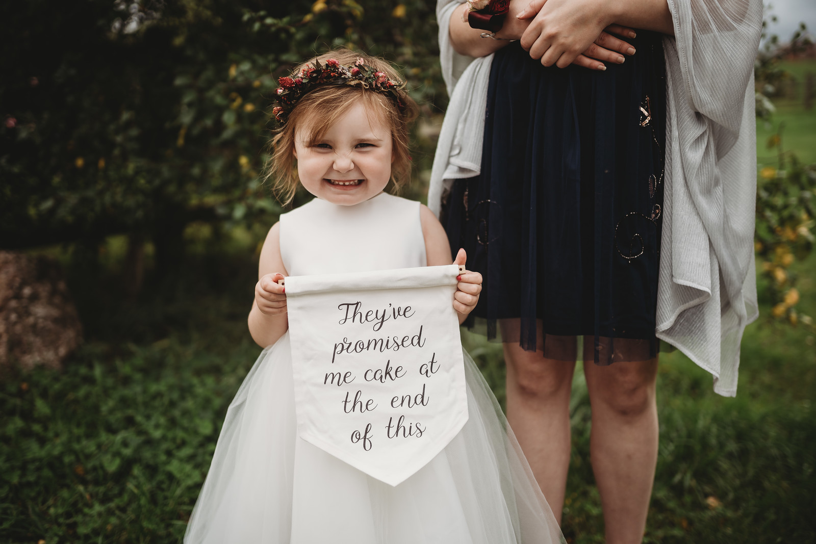 Young child holding a wedding sign