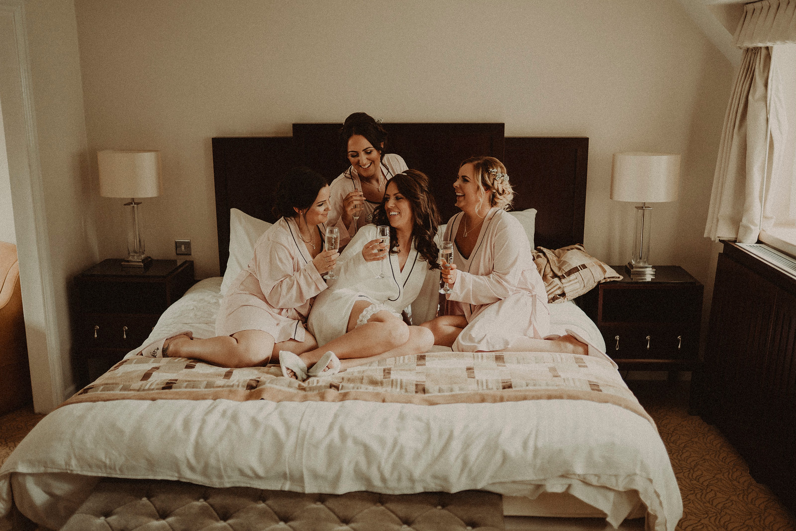 Bride and bridesmaids getting ready wedding photo