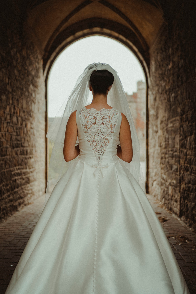 Back of brides dress| Wedding Photographer and Videographer