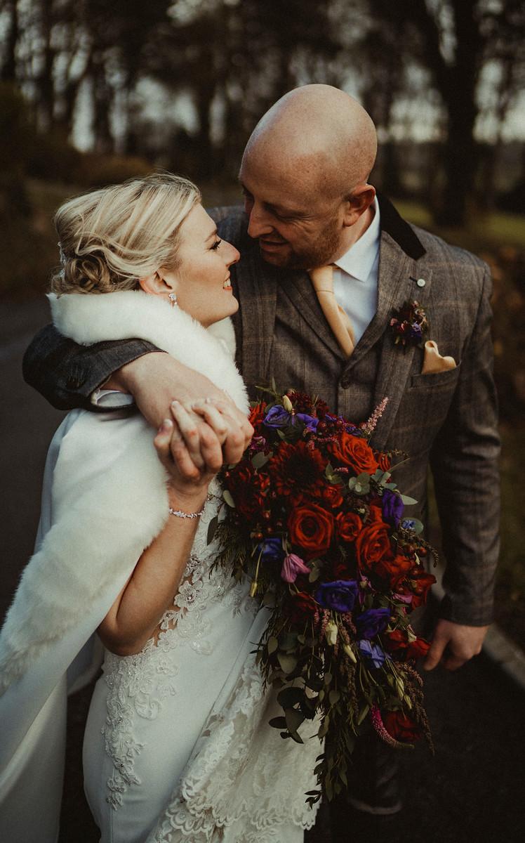 Bride and groom hug each other| Wedding Photos