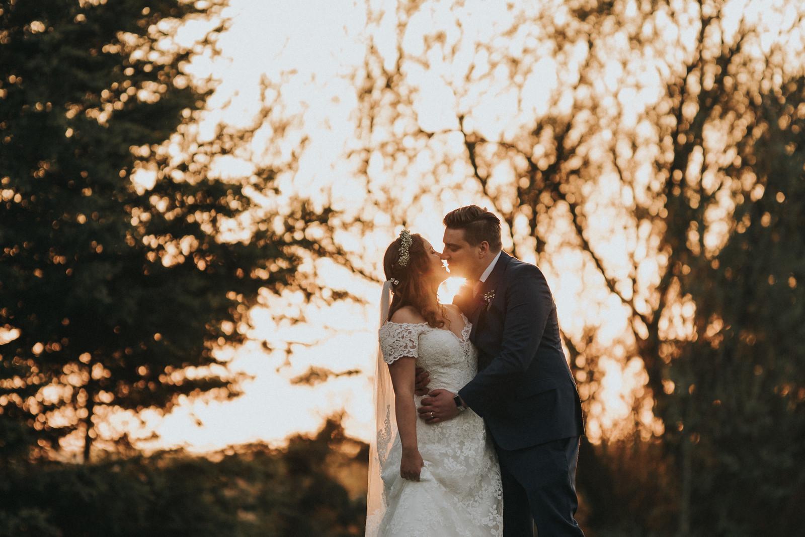 Bride and groom sunset wedding photo - wedding photography Northumberland