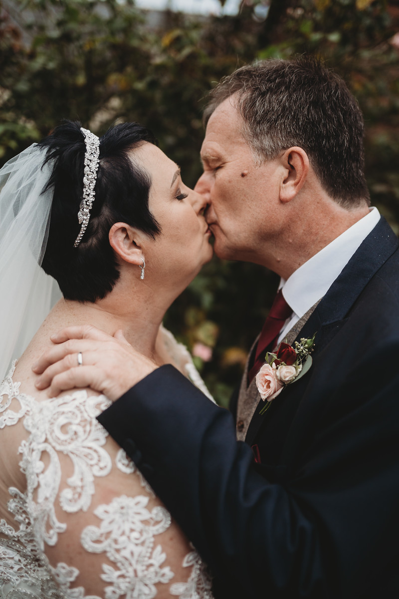 Bride and groom kiss wedding photo