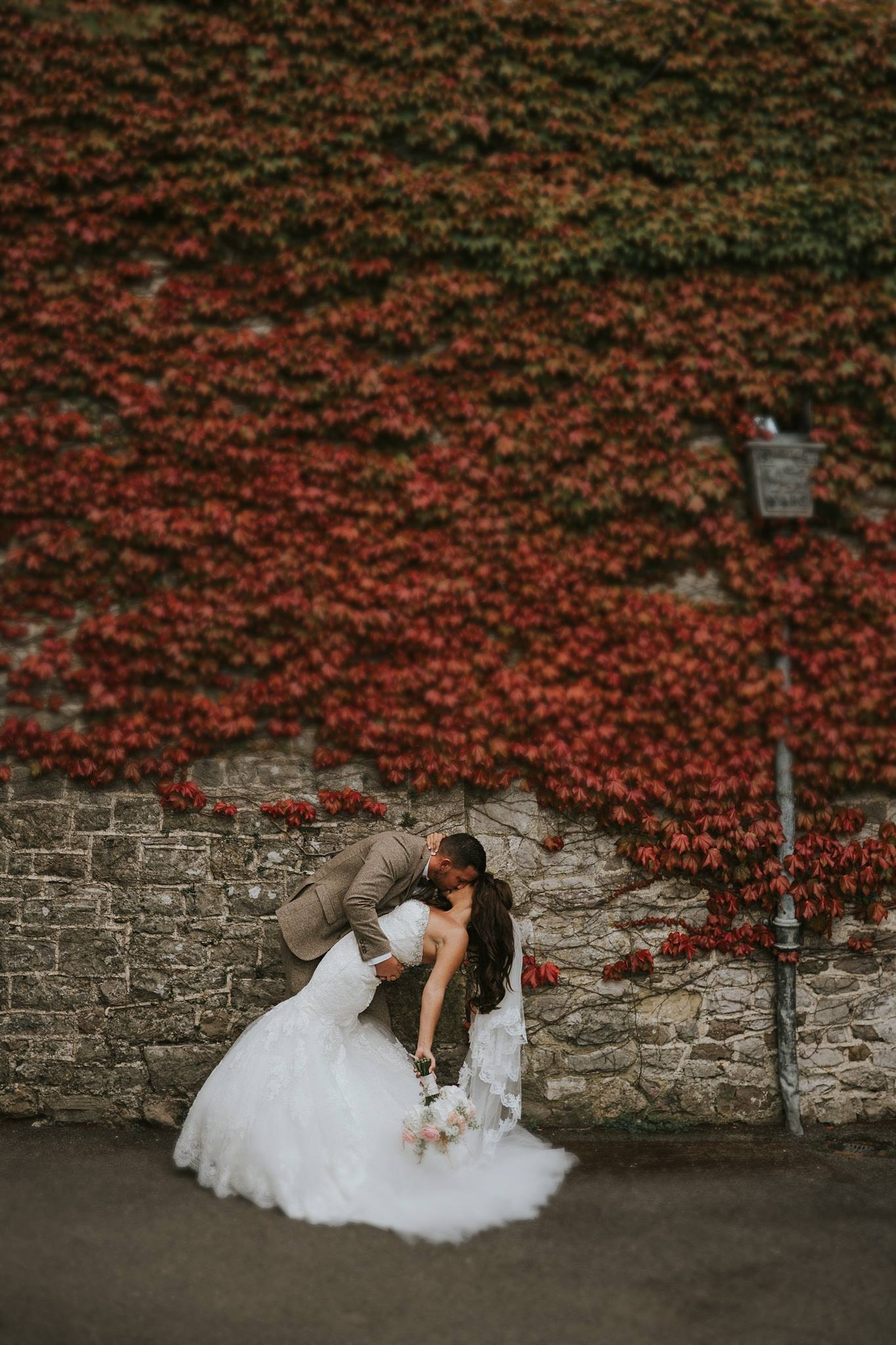 Bride and groom kiss wedding image