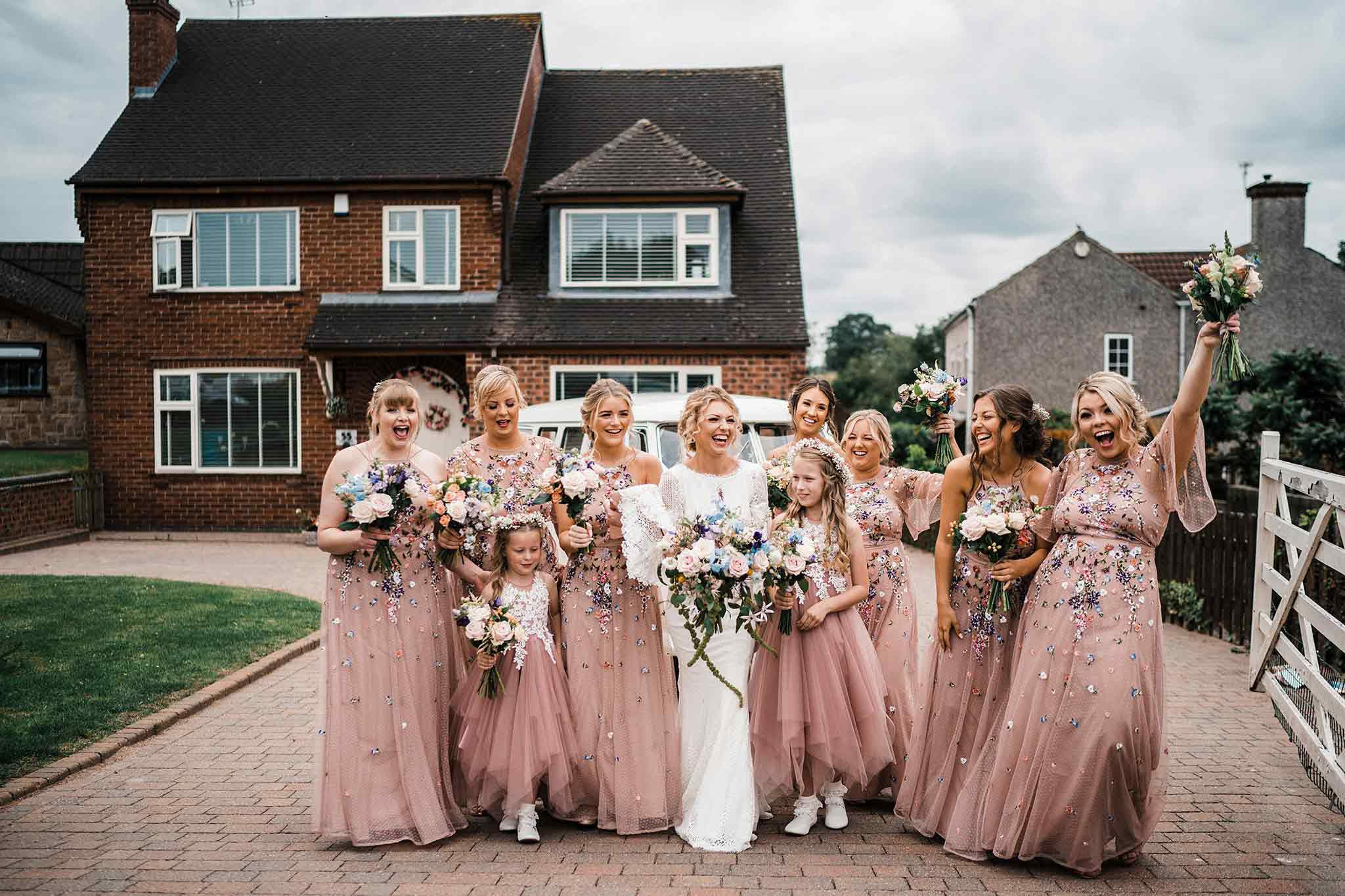 Bride and bridesmaids captured laughing together| Fine art photography