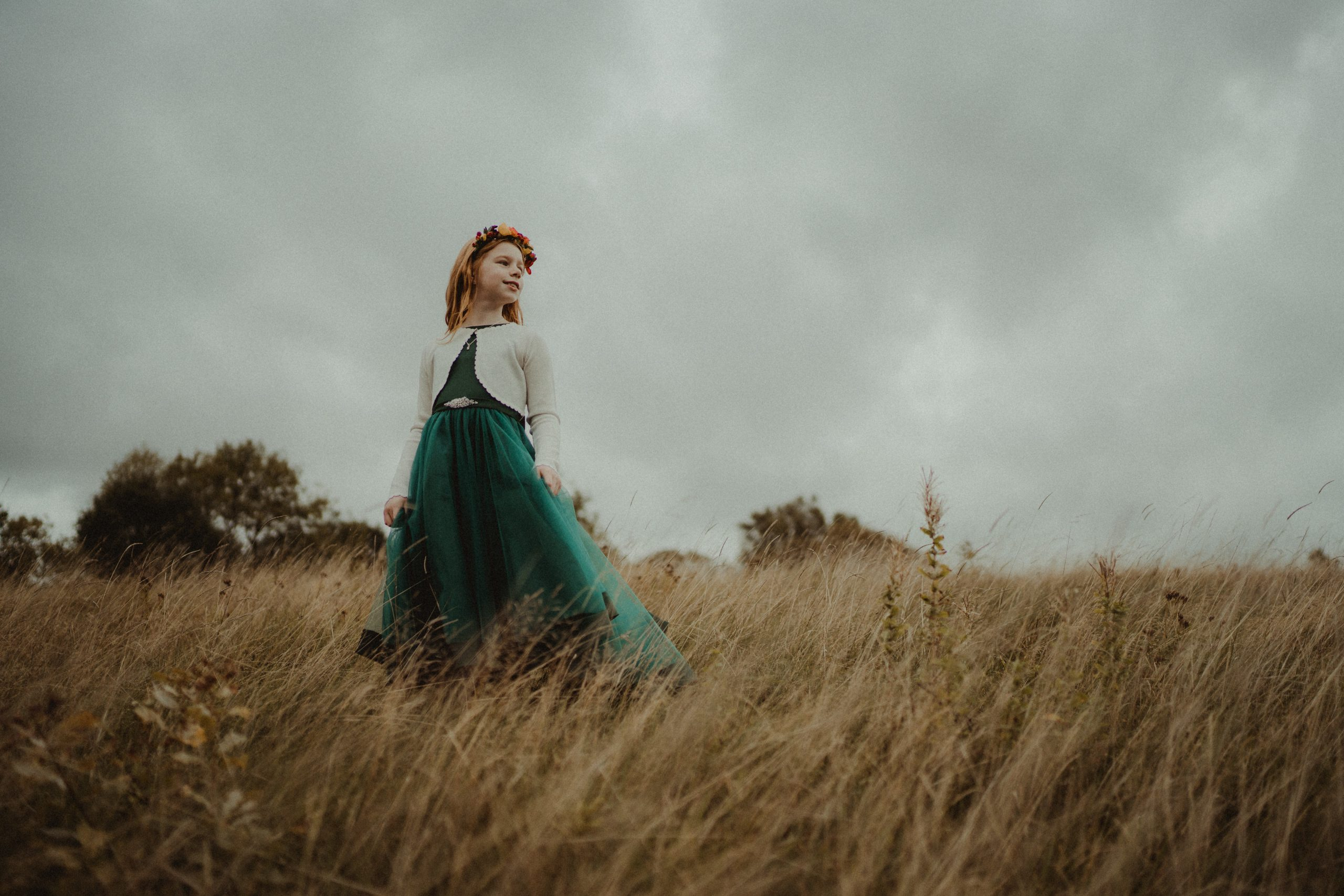 A young girl in the middle pf a field