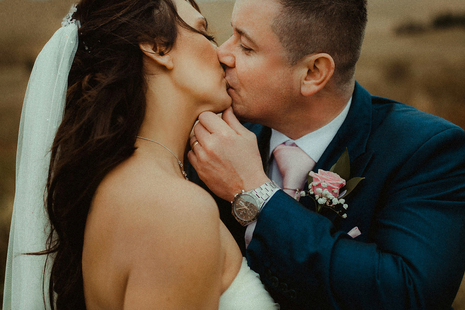 Close up Wedding Photo of Bride and Groom Kissing