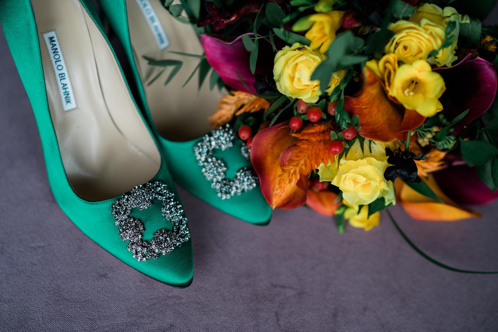 Wedding photo of bridal shoes and wedding flowers