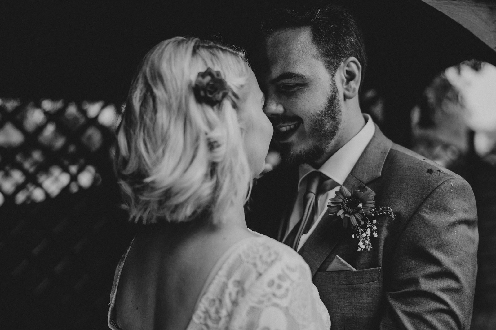 Close up of bride and groom, full of smiles