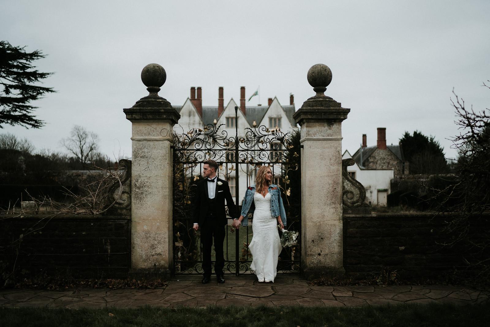 Bride and Groom Wedding Photo Outside Venue - Rustic Theme Wedding Photo - Wedding Photographers Swansea