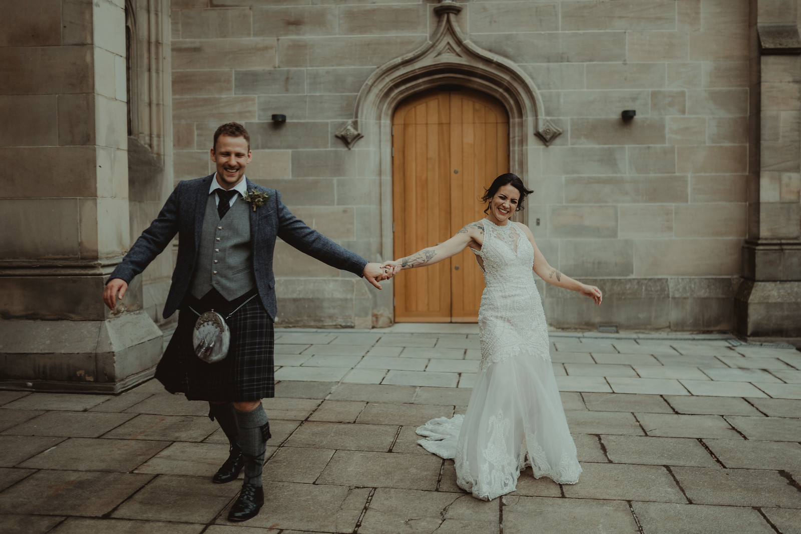 Full of smiles and laughter wedding photo of bride and groom