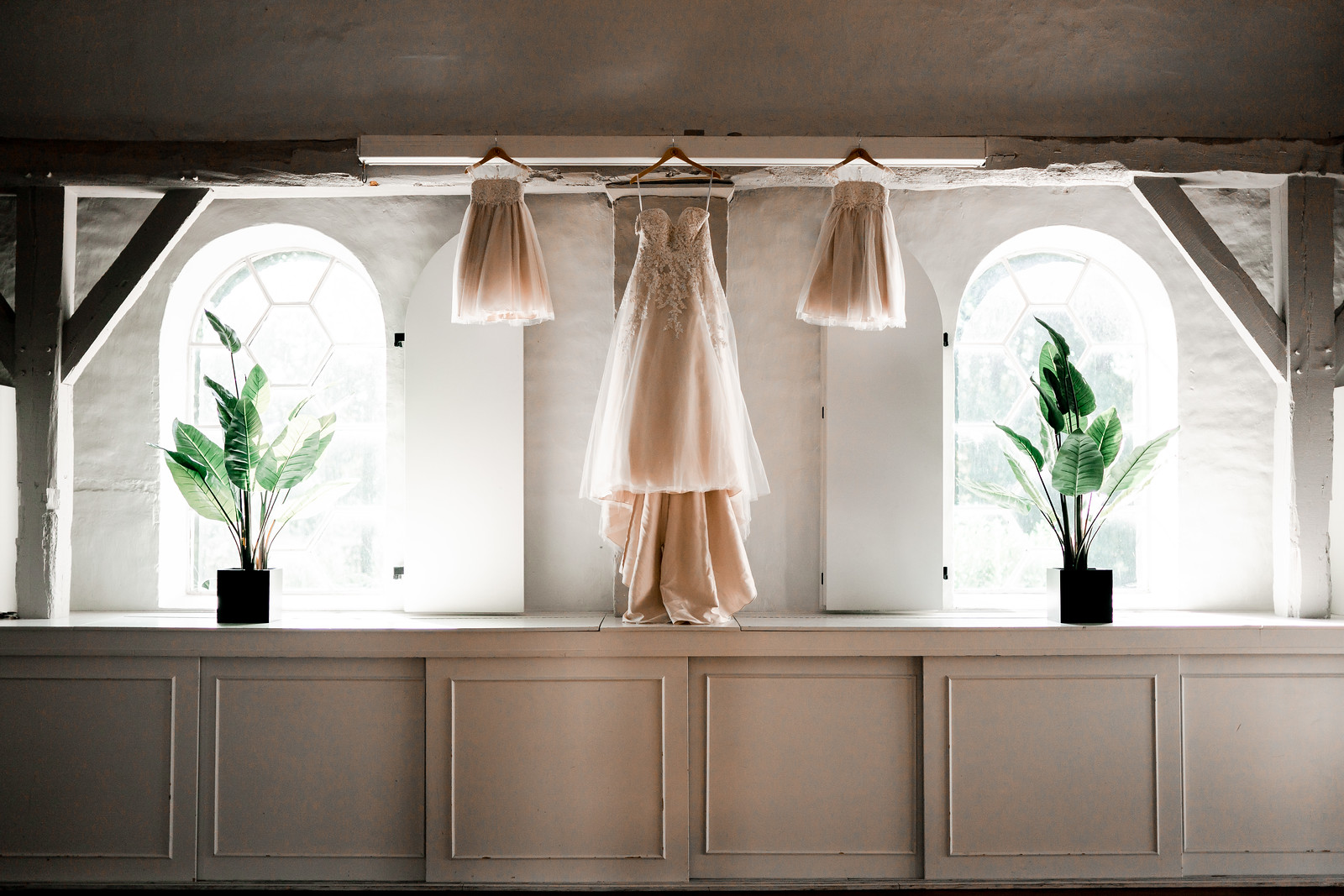 Brides and daughters dresses hung up