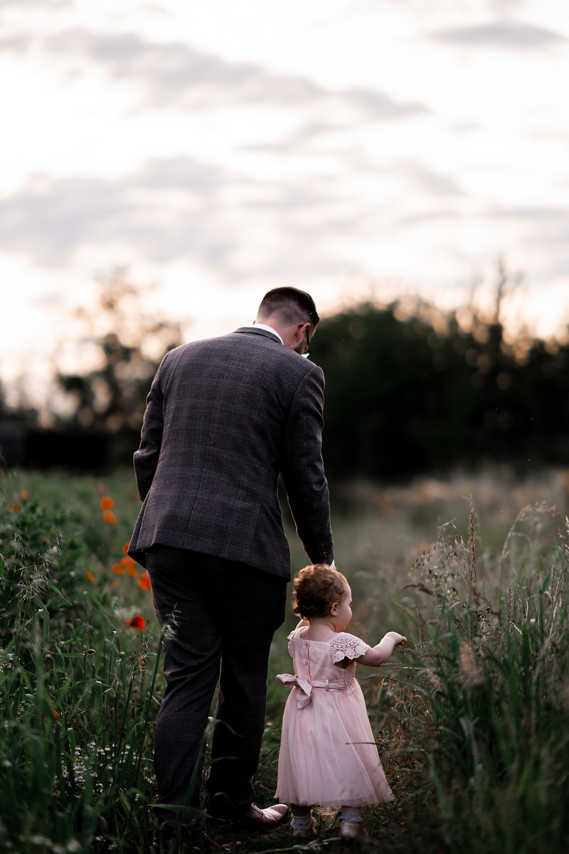 Groom and daughter wedding photo