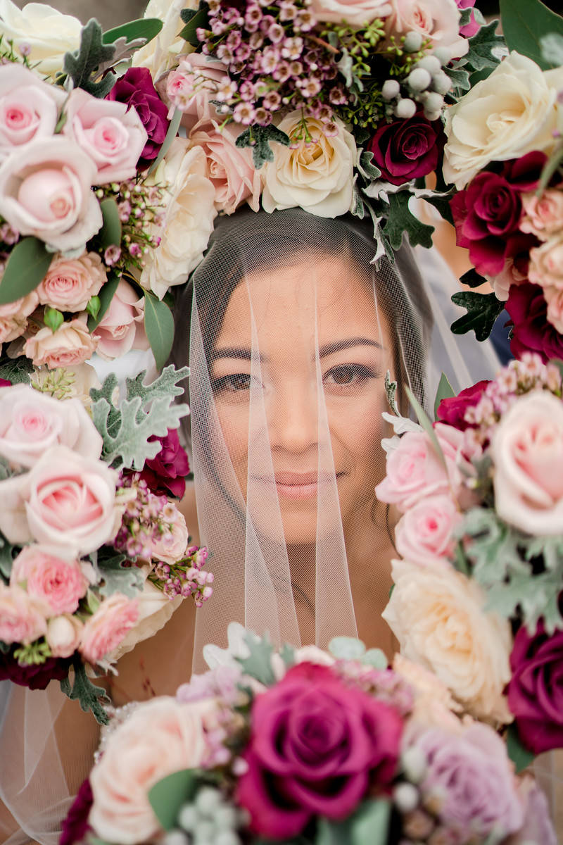 Creative wedding photo of bride - flowers all around her face