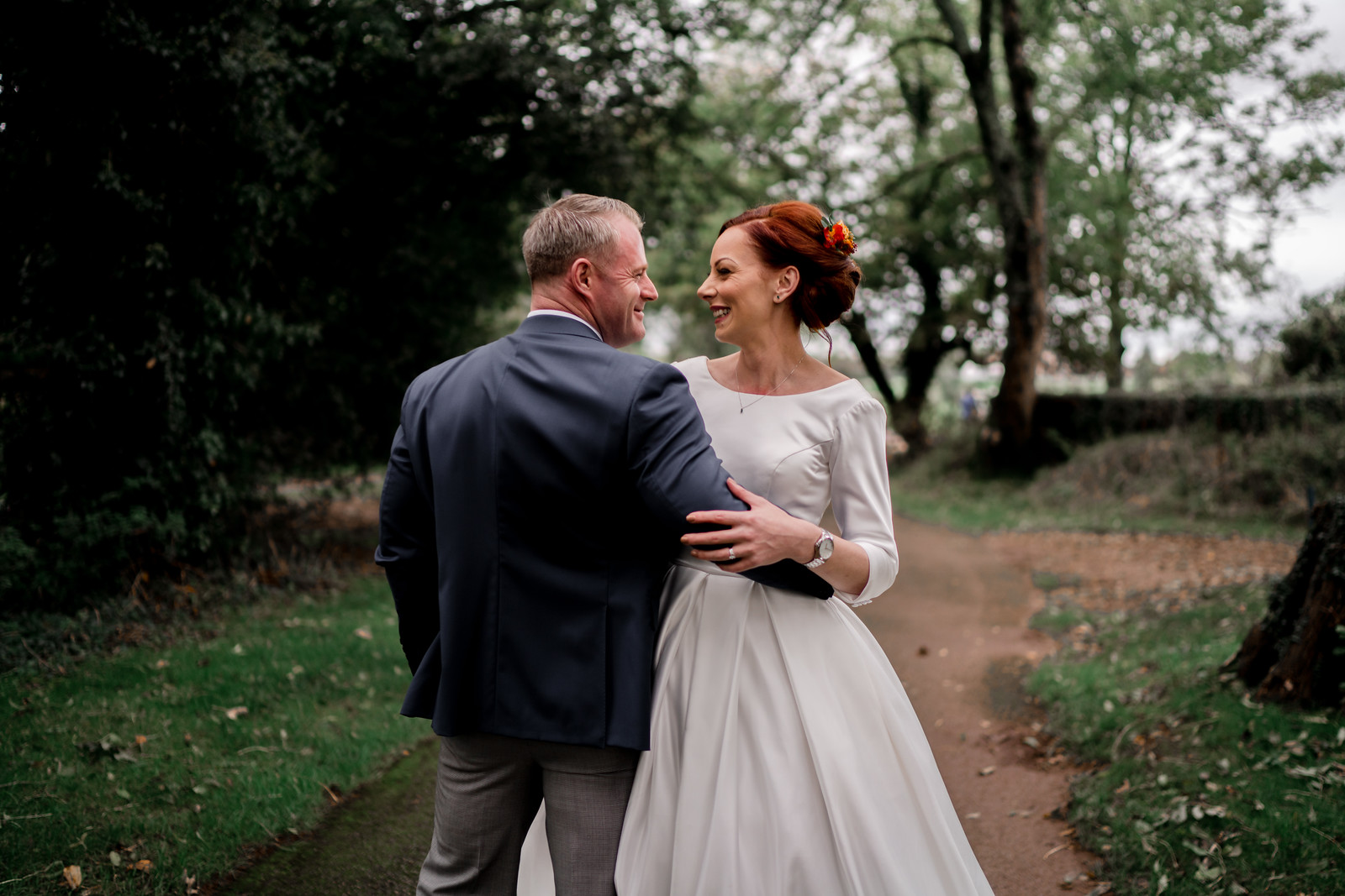 Bride and Groom Wedding Photo Full Of Smiles