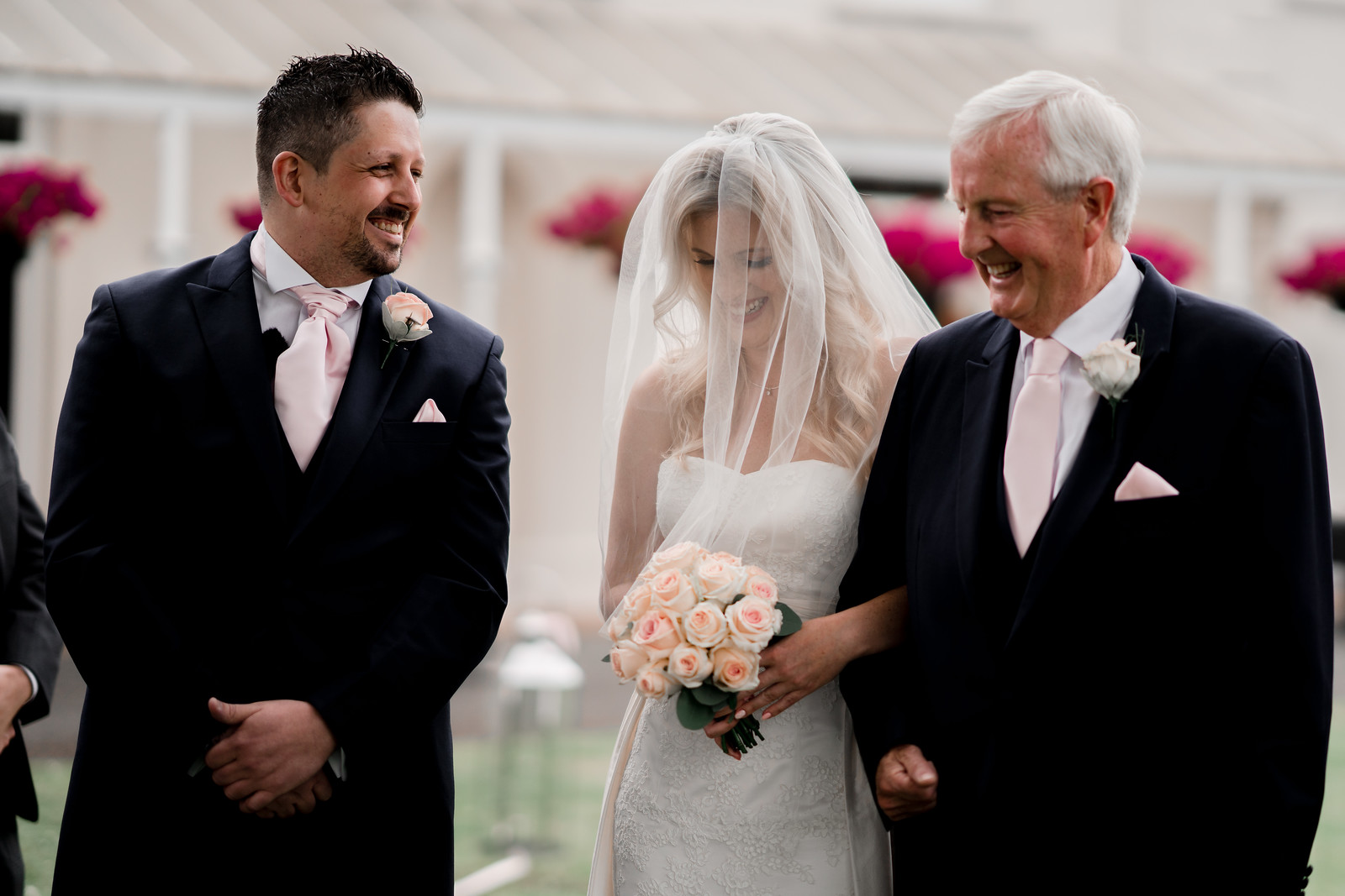 Smiles all round as father walks daughter down the aisle and meets the groom