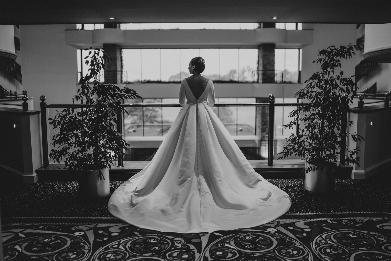 Back of the bride in the stunning elegant dress