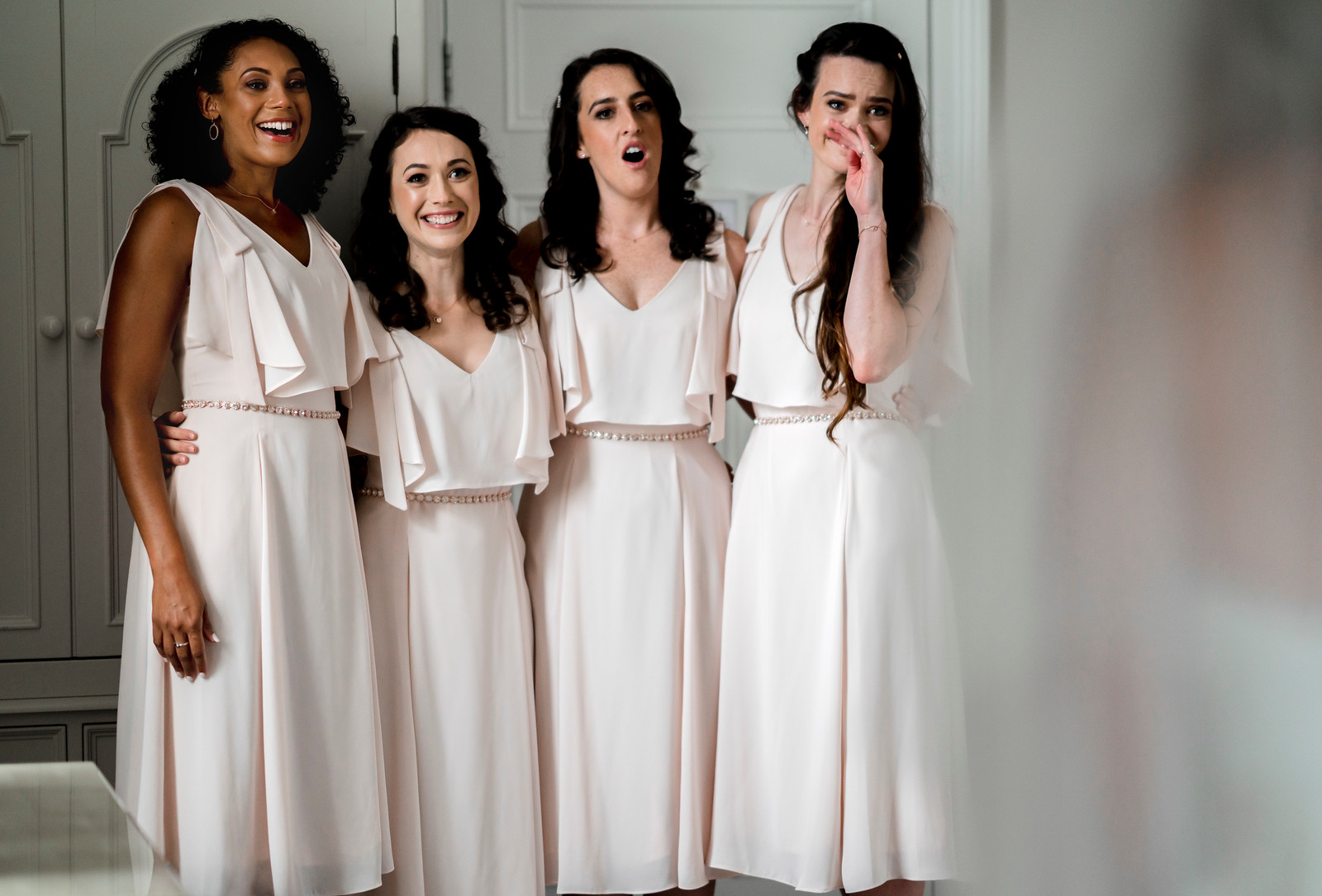 Bridesmaids reaction to seeing the brides dress for the first time