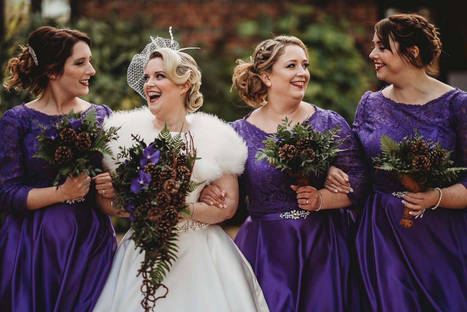 Bride and Bridesmaids full of smiles wedding photo