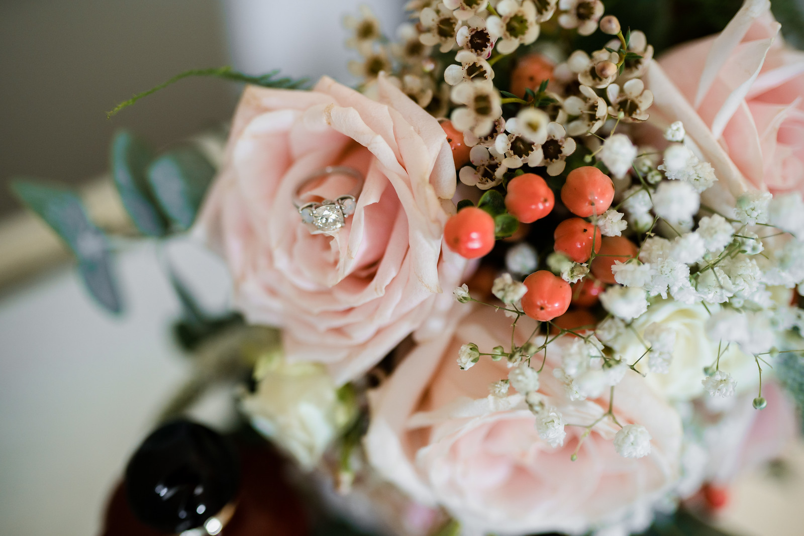 Brides wedding flowers and ring