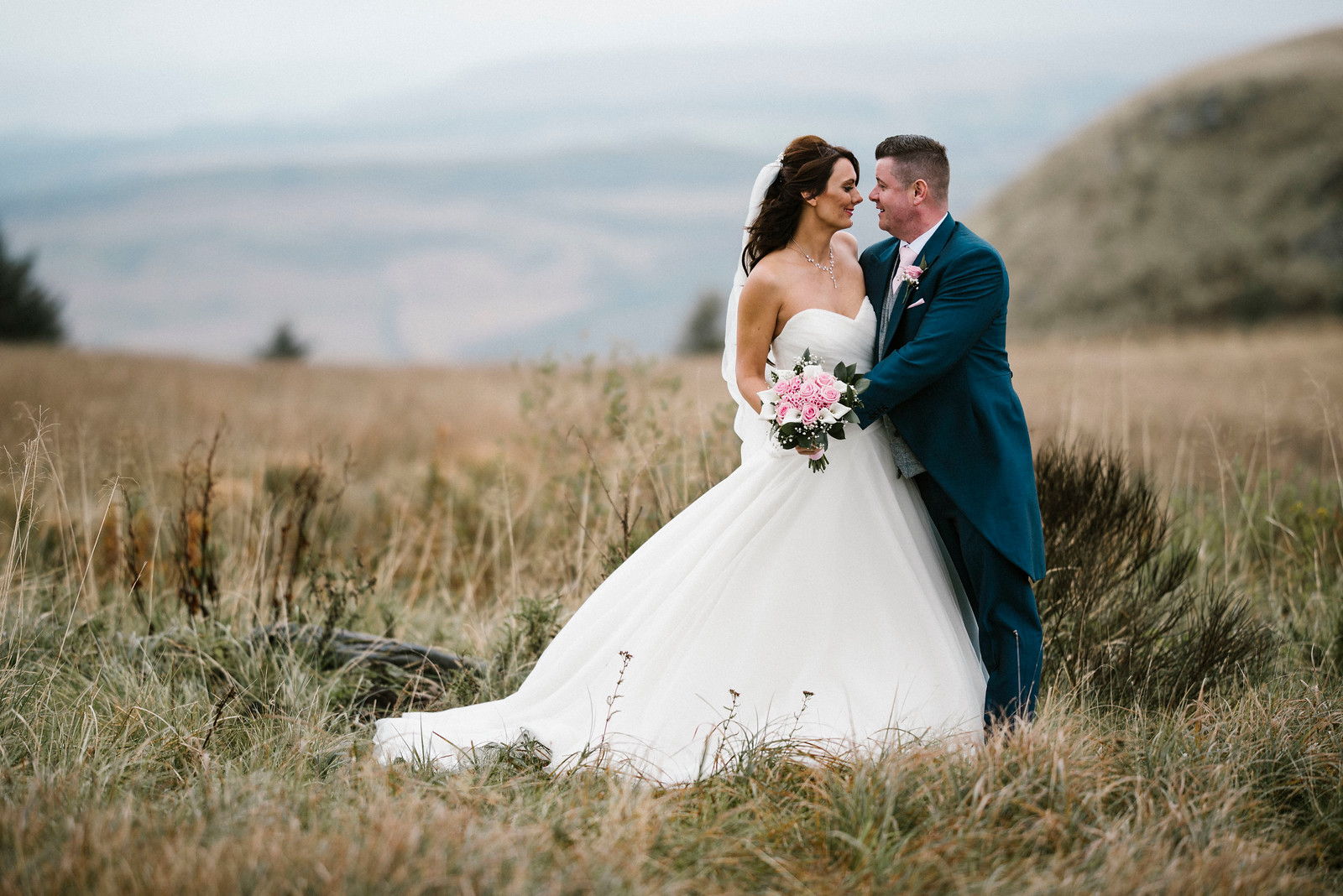 Bride and Groom Full of Smiles Wedding Photo - Countryside Location