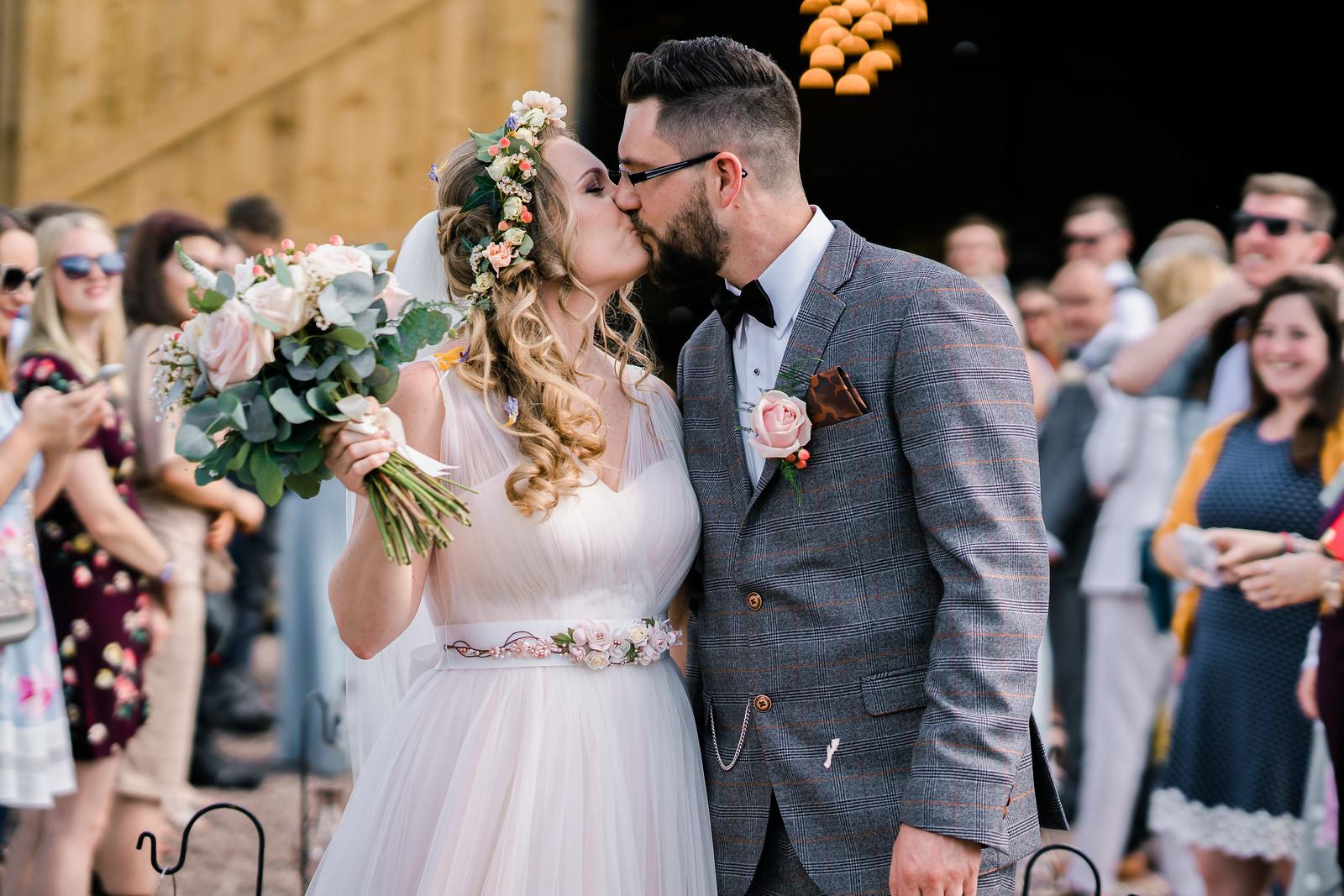 Bride and groom kiss wedding photo