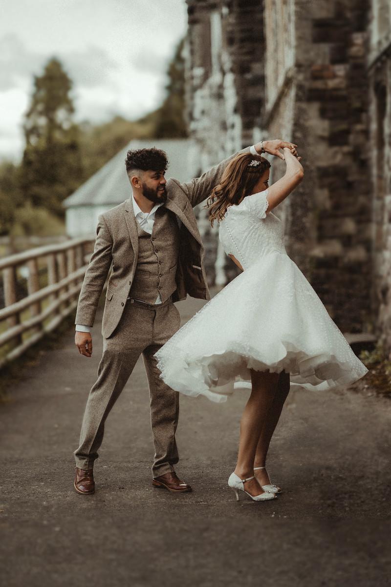 Bride and groom dancing outside their wedding venue