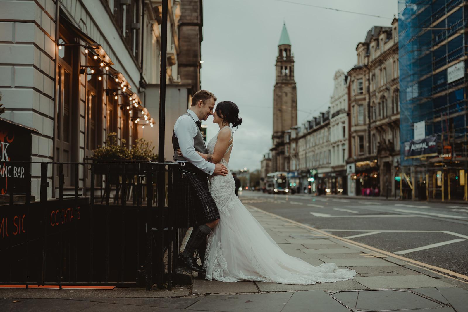 Bride and groom wedding photo within a street in Edinburgh