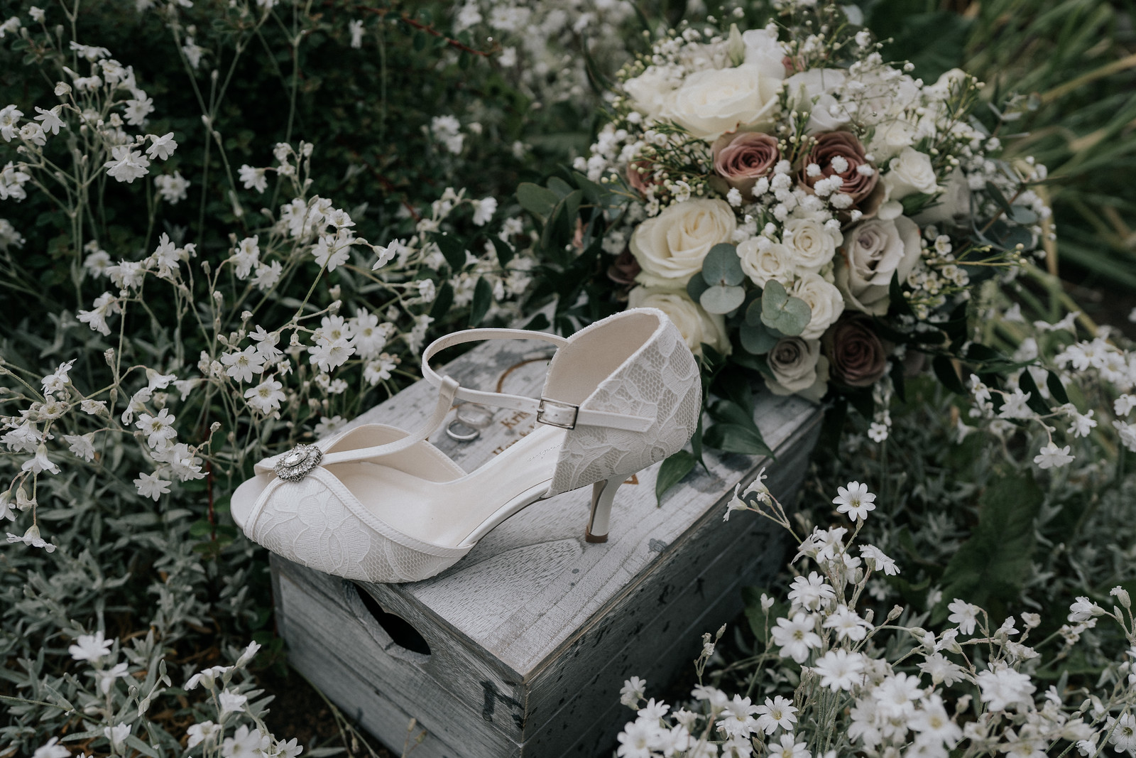 Photo of wedding flowers and the brides wedding shoes