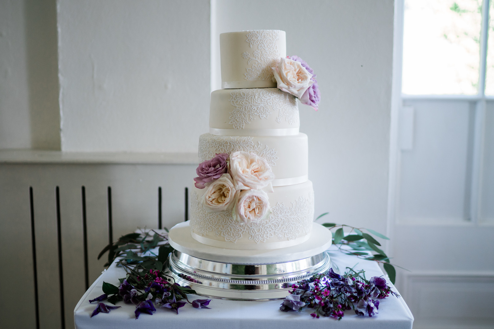 White wedding cake with flowers as decoration