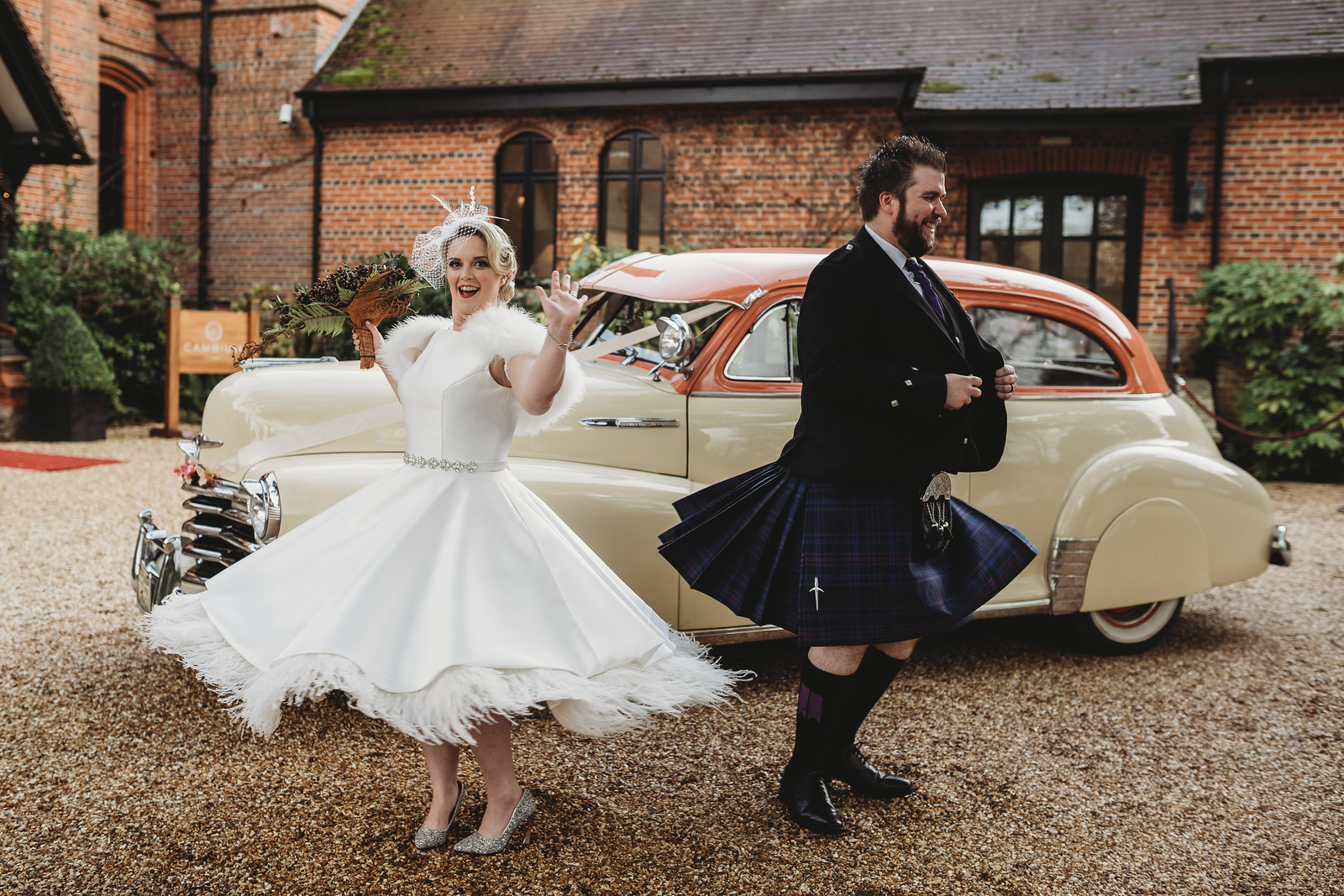 Bride and groom dance in front of the venue - Fun wedding photo