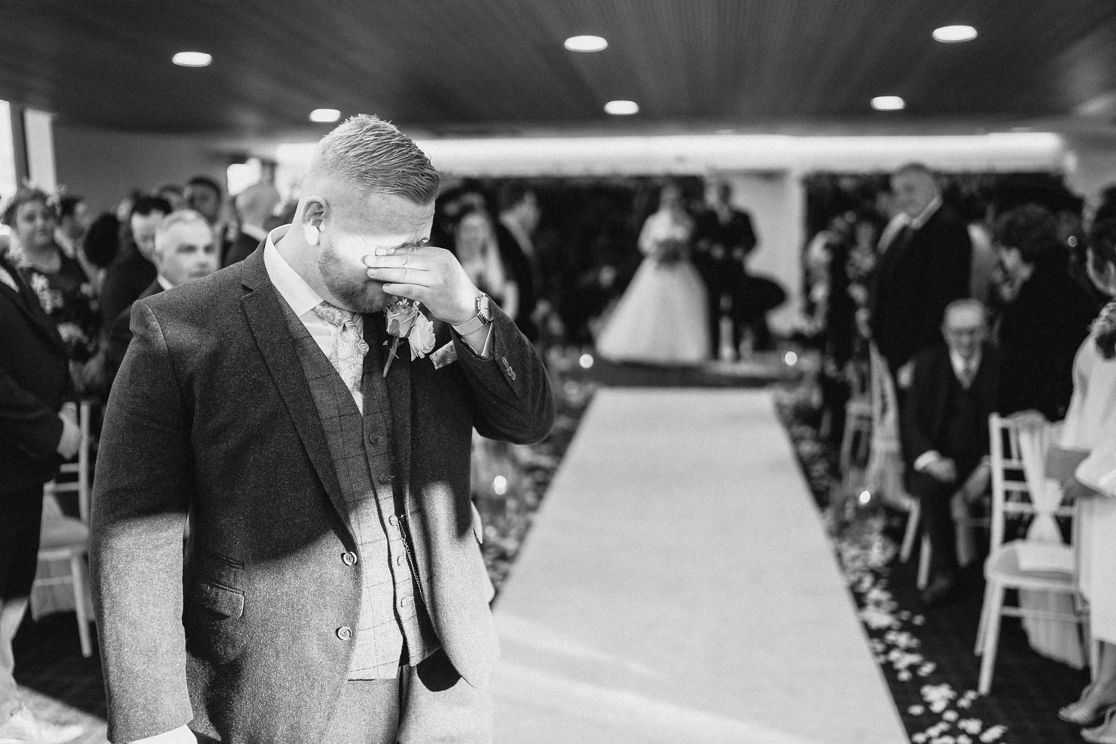 Groom tears up as she sees his bride for the first time in her wedding dress