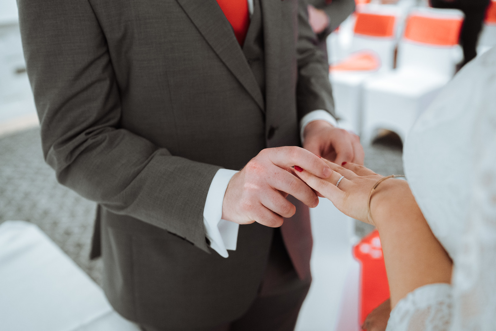 Groom puts on the brides ring