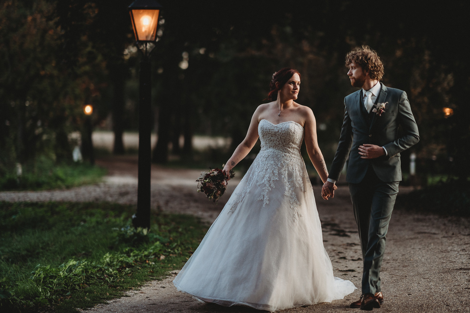 Bride and groom walk through the beauty surrounding their venue