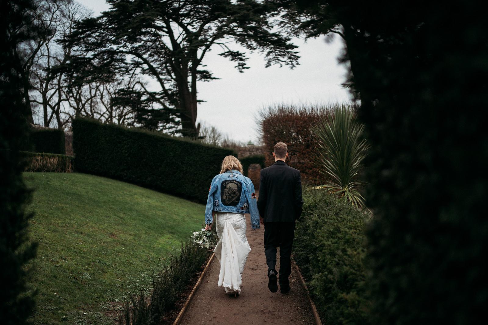 Behind shot of bride and groom