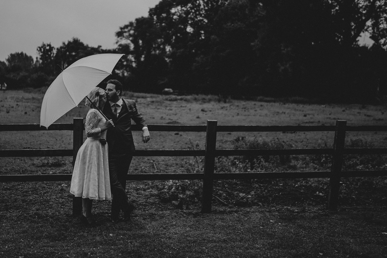 Bride and groom in the middle of the beauty of the outside of their venue