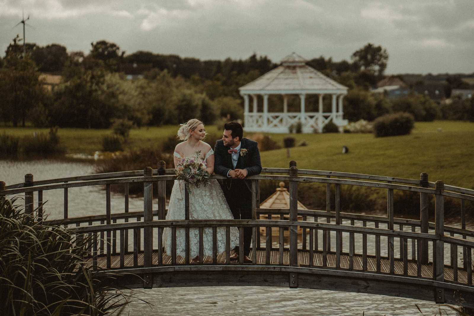 Bride and groom wedding photo surrounded by beauty
