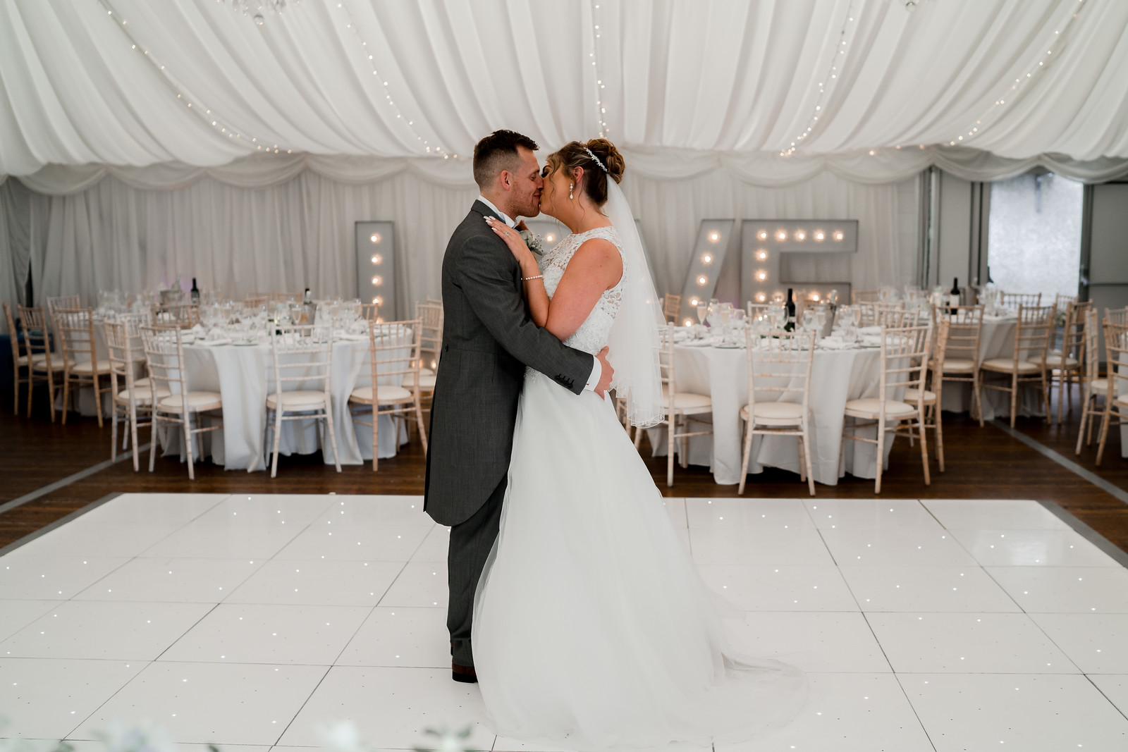 Bride and groom kiss in the middle of their reception