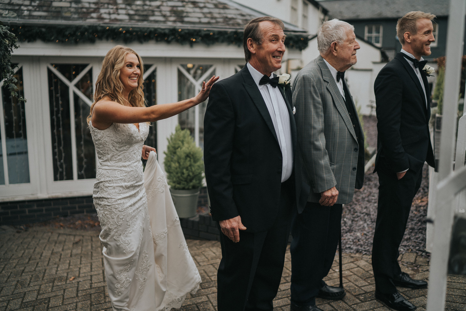 Groom shows the important men of her life her wedding dress