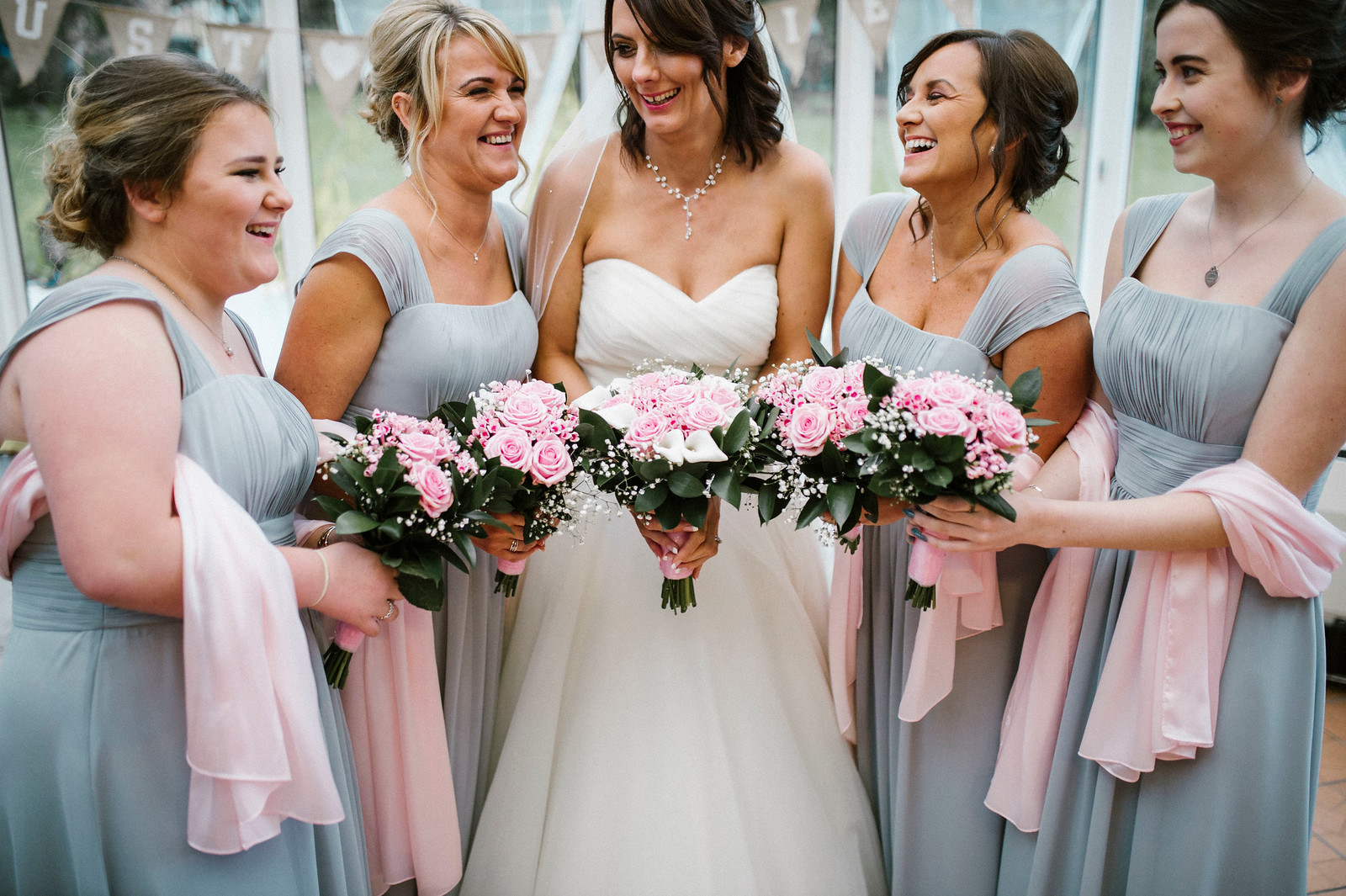 Bride and bridesmaids wedding photo - Full of smiles