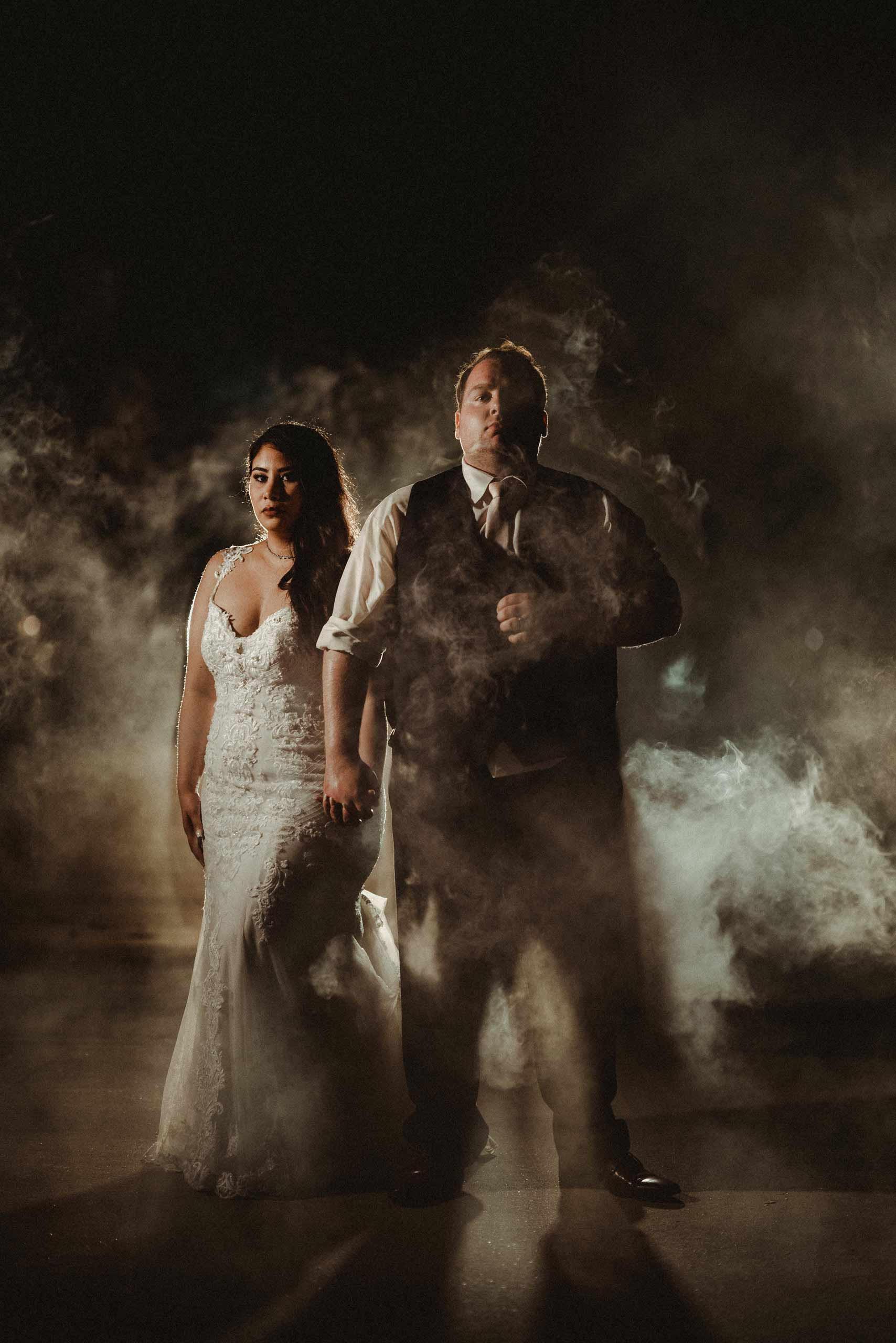 Bride and groom wedding photo with smoke effect