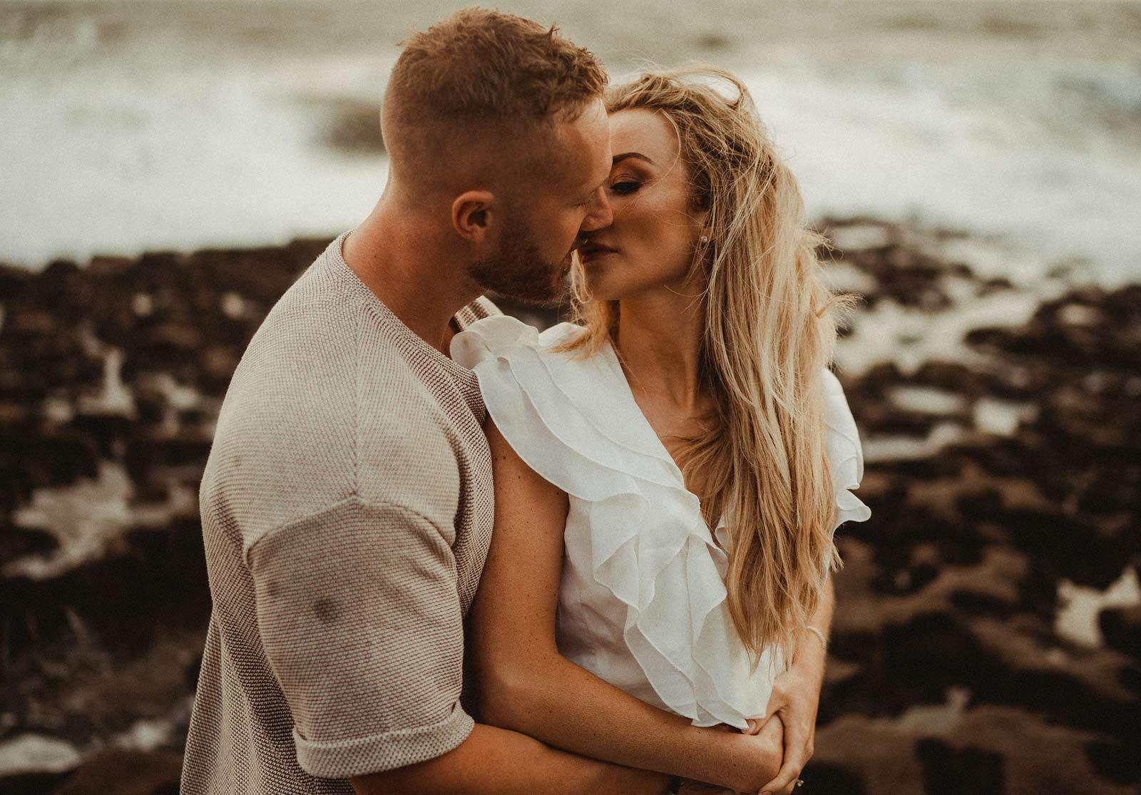A couple kiss on the beach - close up photo