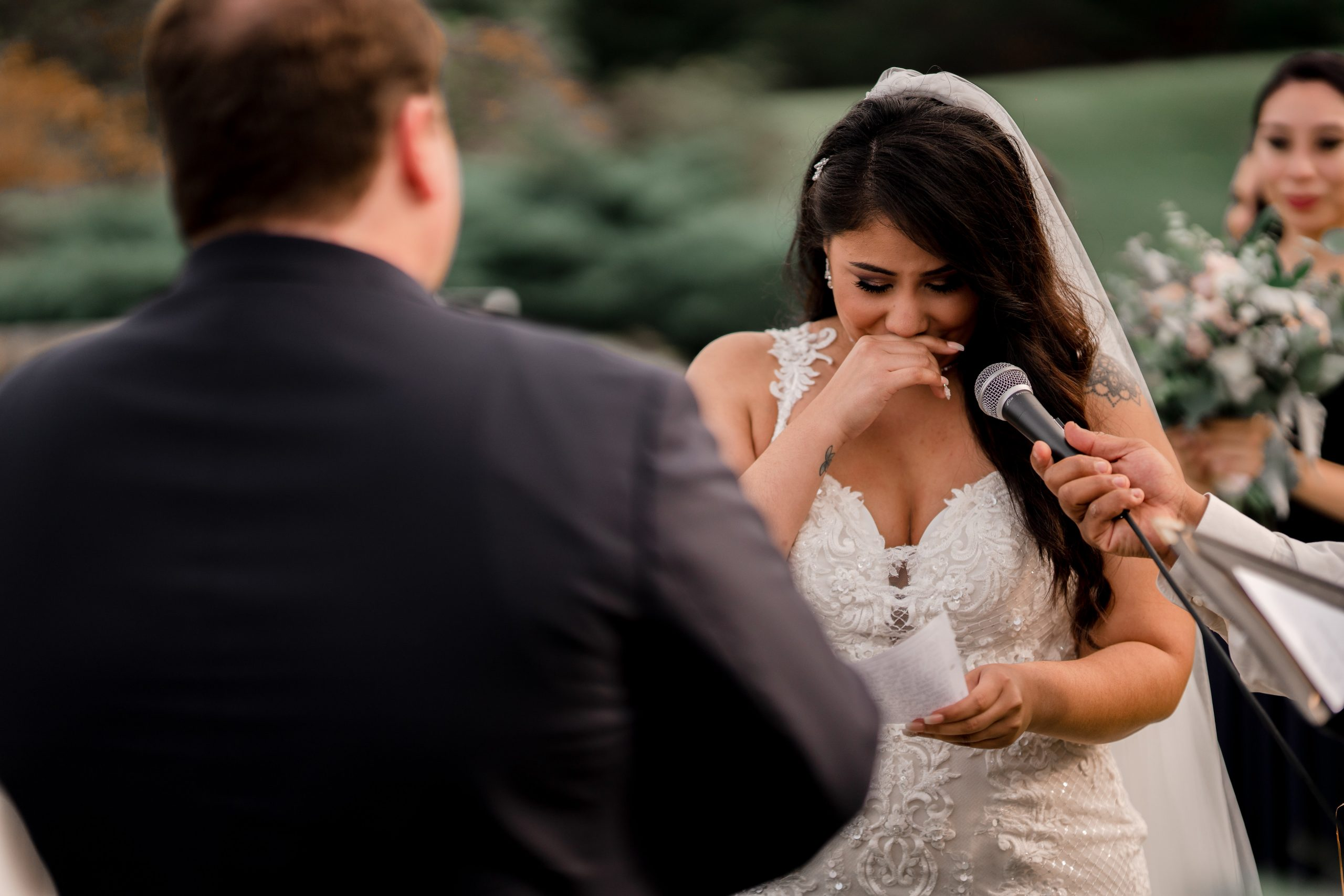 Bride cries as she reads out her vows