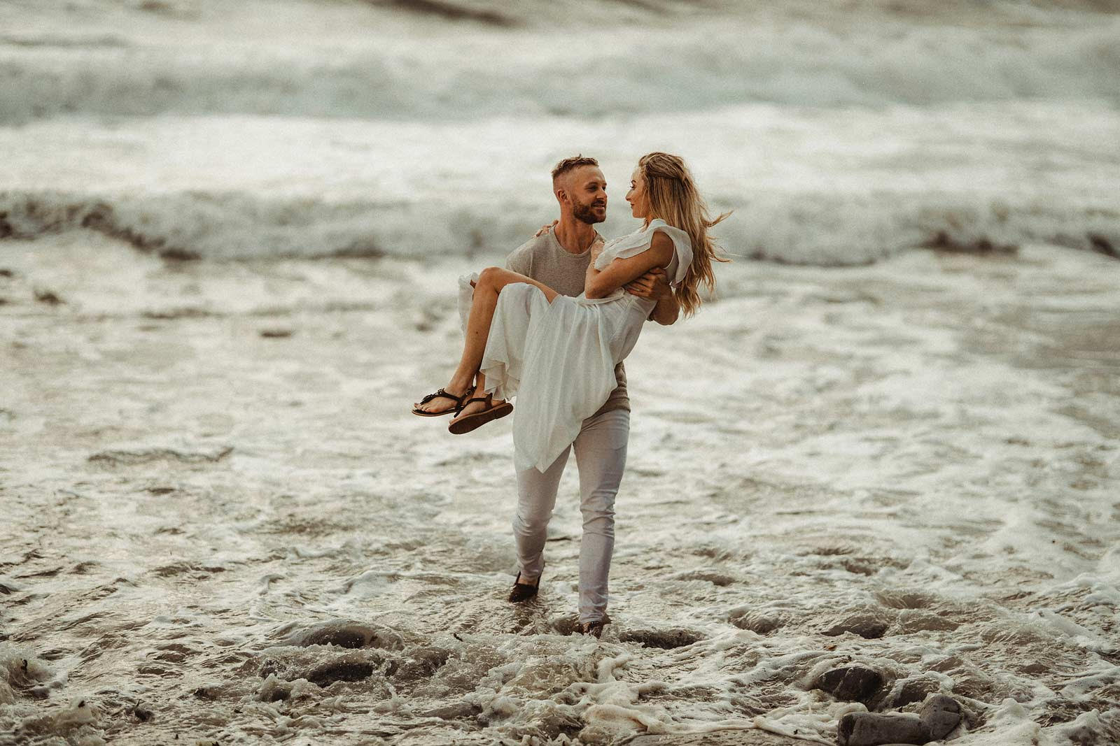 Couple is captured in the middle of the sea