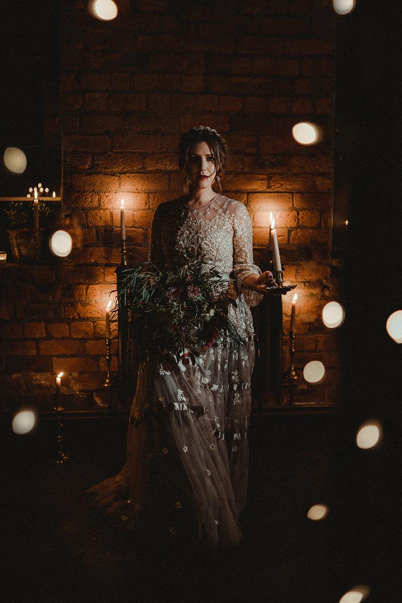 Bride is standing around with lights around around her