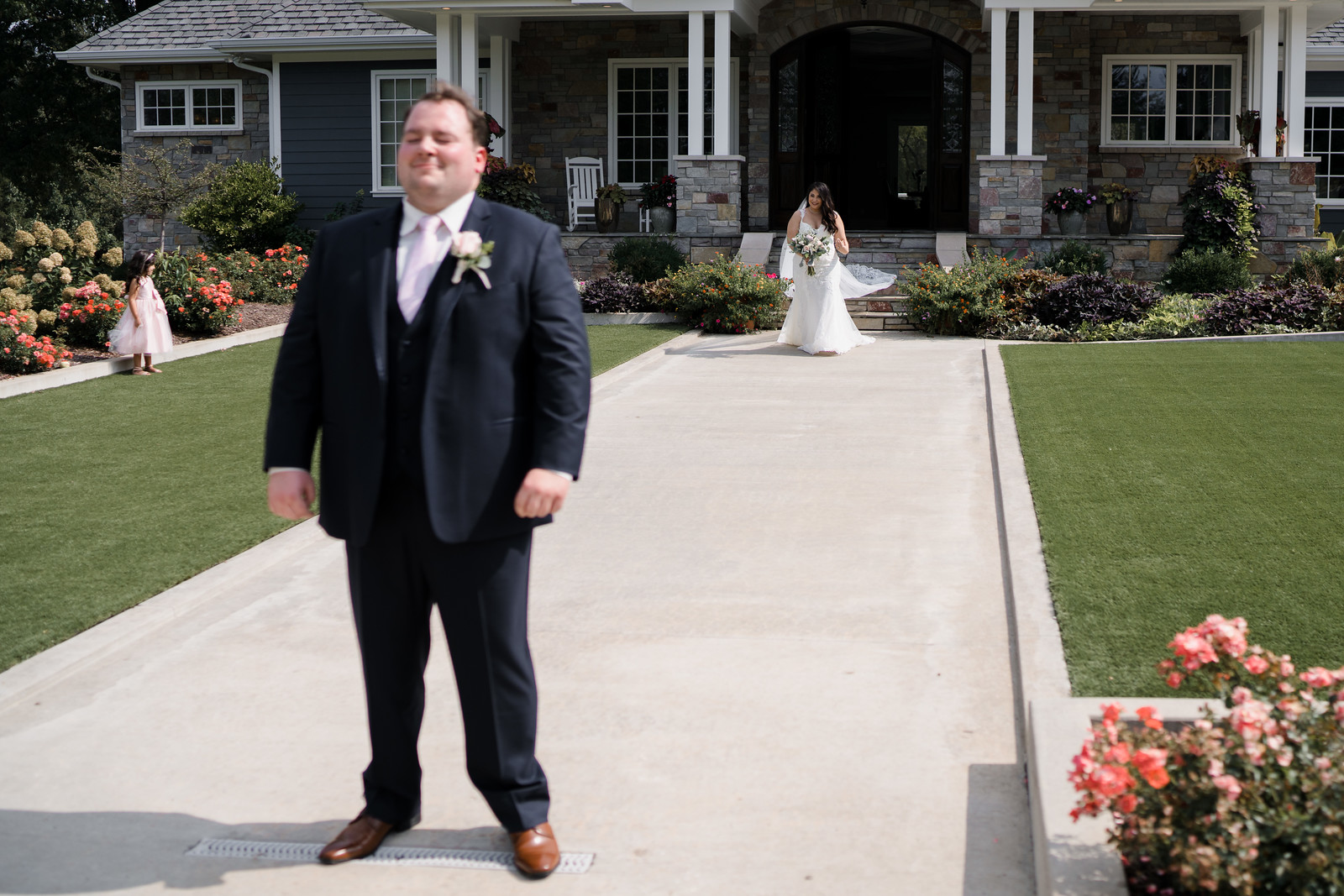 Bride walks towards her groom, the groom has a big smile on his face