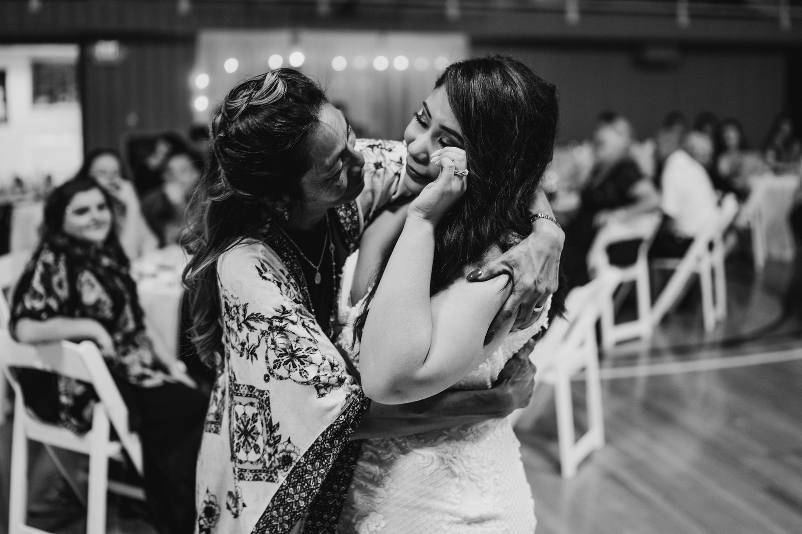 Bride cries as she dances with her mother